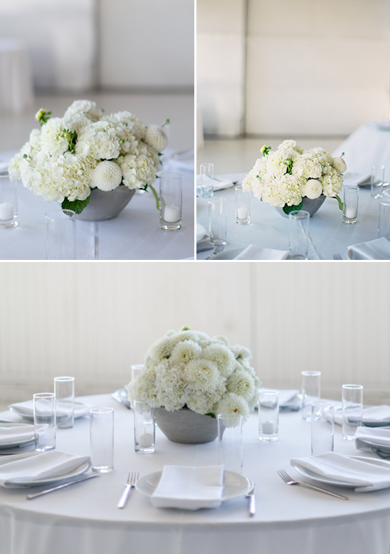 elegant white centerpieces at white tables