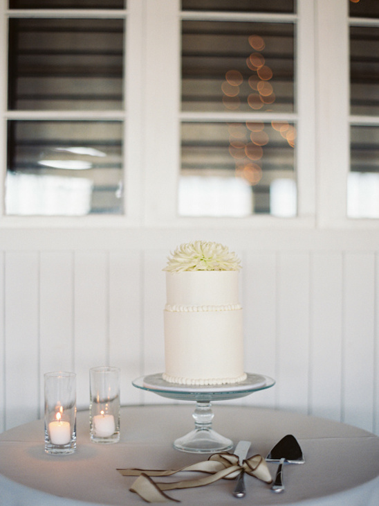 wedding cake table with simple white wedding cake