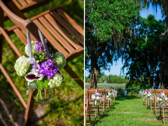 hanging flower vases as aisle decor