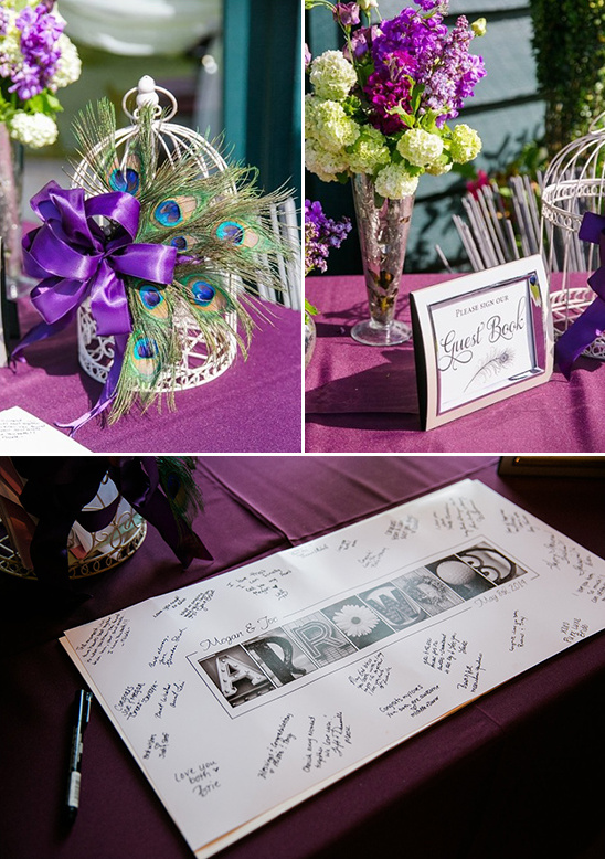 guestbook table decked out in purple and peacock feathers