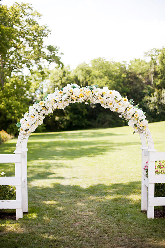 yellow and white floral arch backdrop