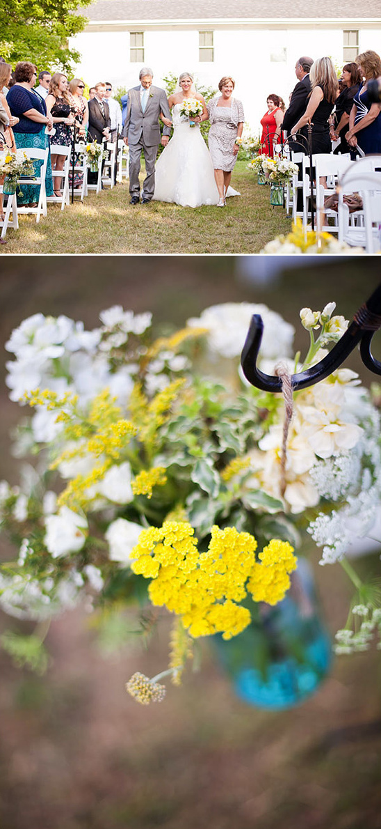 white and yellow flowers in blue mason jars