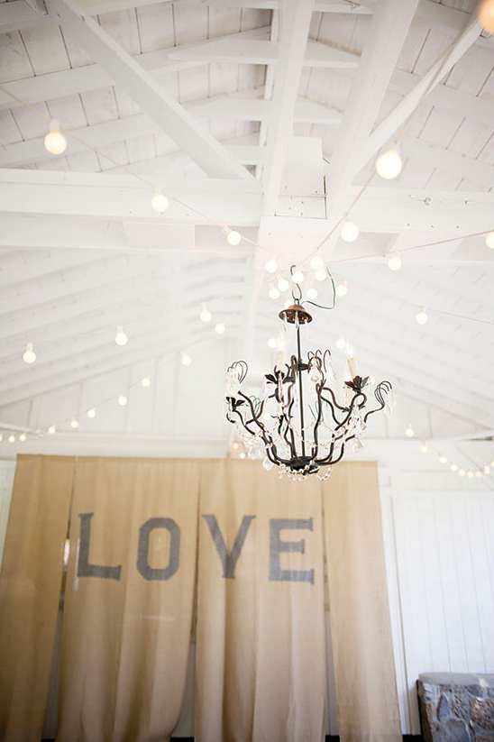 chandelier and love backdrop