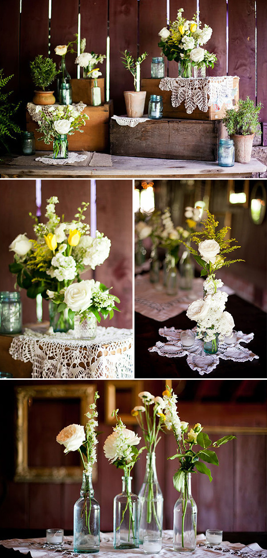 single stem florals in glass bottles