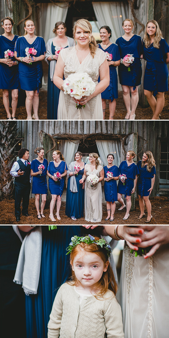 blue bridesmaids and cute red headed flower girl