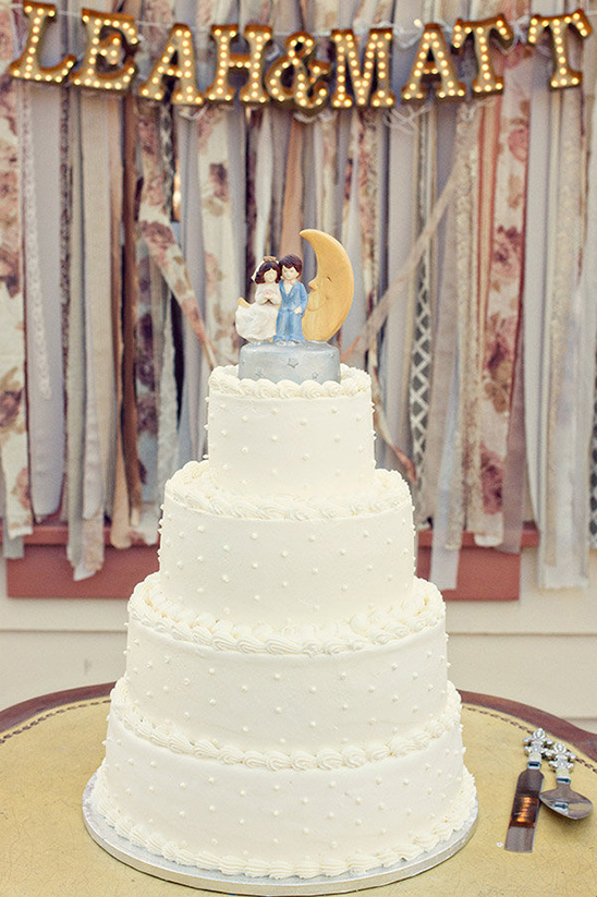 wedding cake with couple on the moon topper