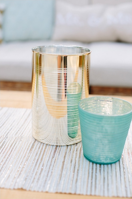 gold and teal candle holders