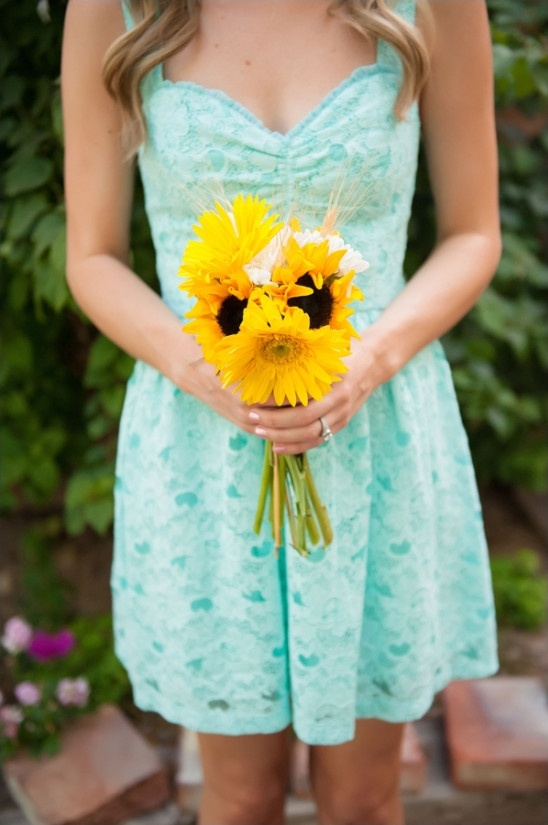 mint bridesmaids with sunflower bouquet