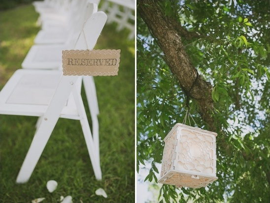 reserved seat sign and lanterns in the trees