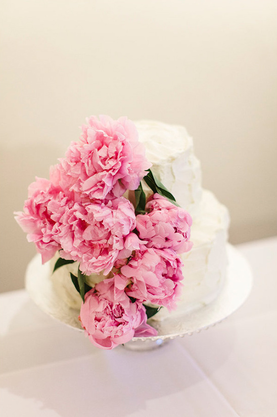 pink peony covered wedding cake