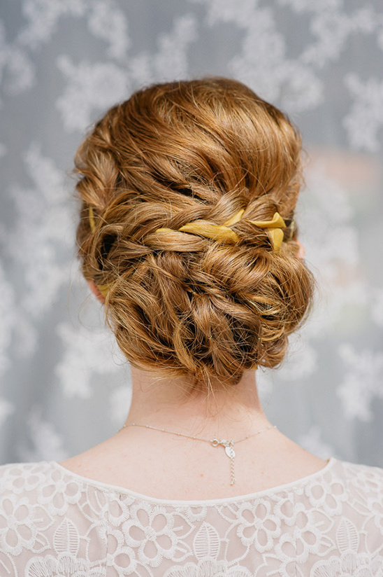 braided low bun wedding hair idea