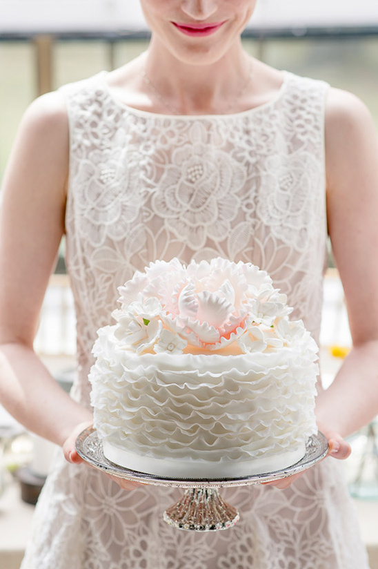 ruffled white shimmer wedding cake
