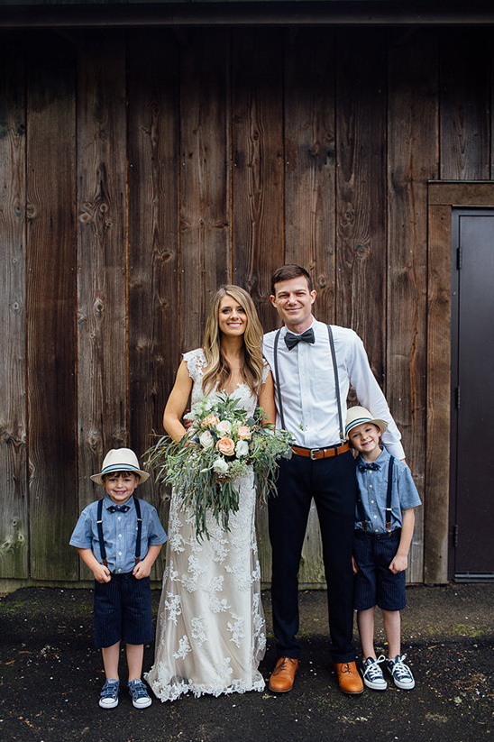 the happy couple with the ring bearers