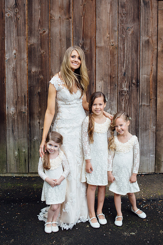 lace wedding gown with matching flower girl dresses
