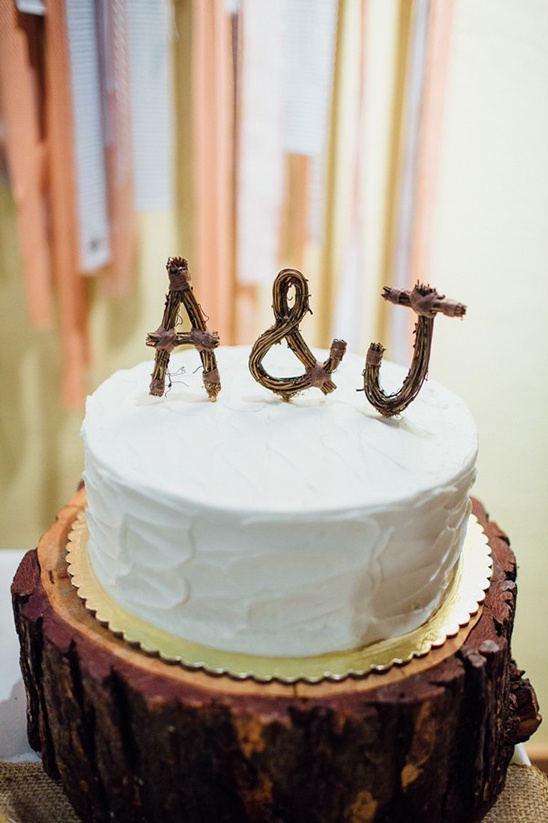 simple wedding cake with cute wooden cake topper