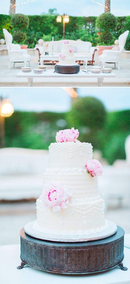 three tier white wedding cake with peonies