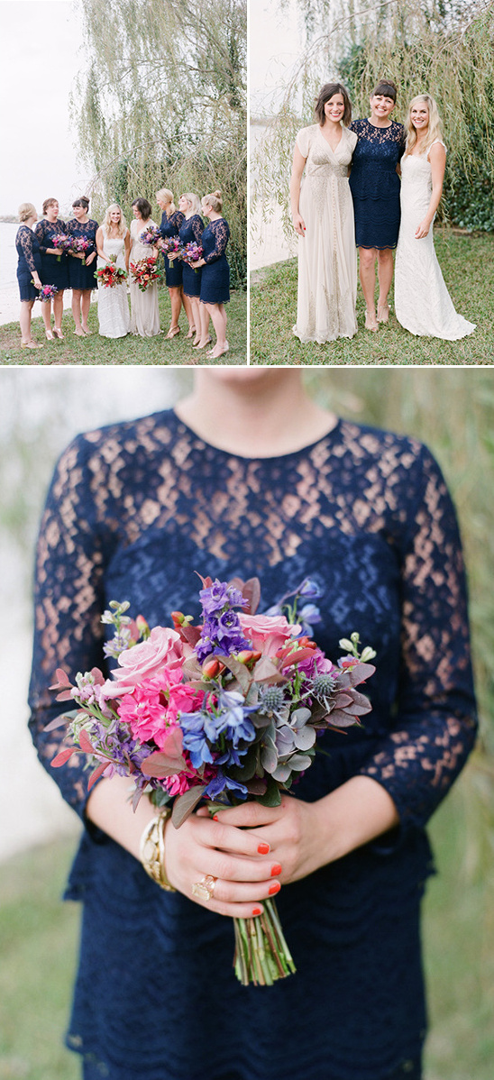 bridesmaids in navy with pink purple and blue bouquets