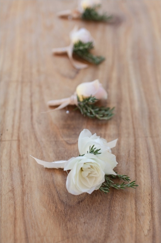 white and pink rose boutonnieres