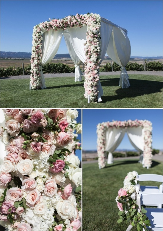 pink and white rose covered wedding arch
