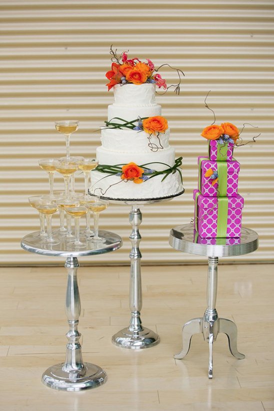 champagne tower with wedding cakes