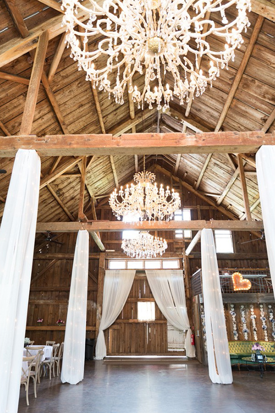 chandelier lit barn