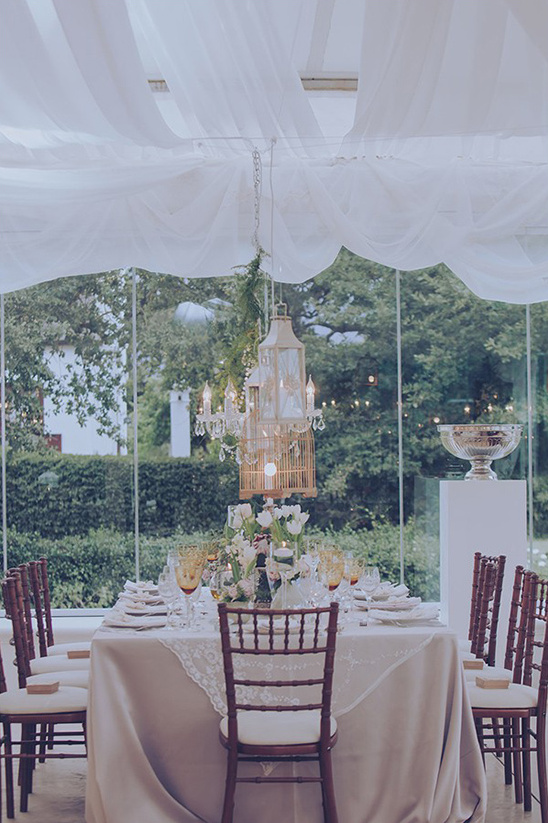 chandelier and lantern lit reception