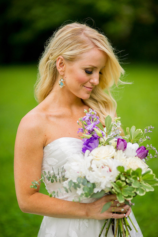 white wedding bouquet with pops of purple