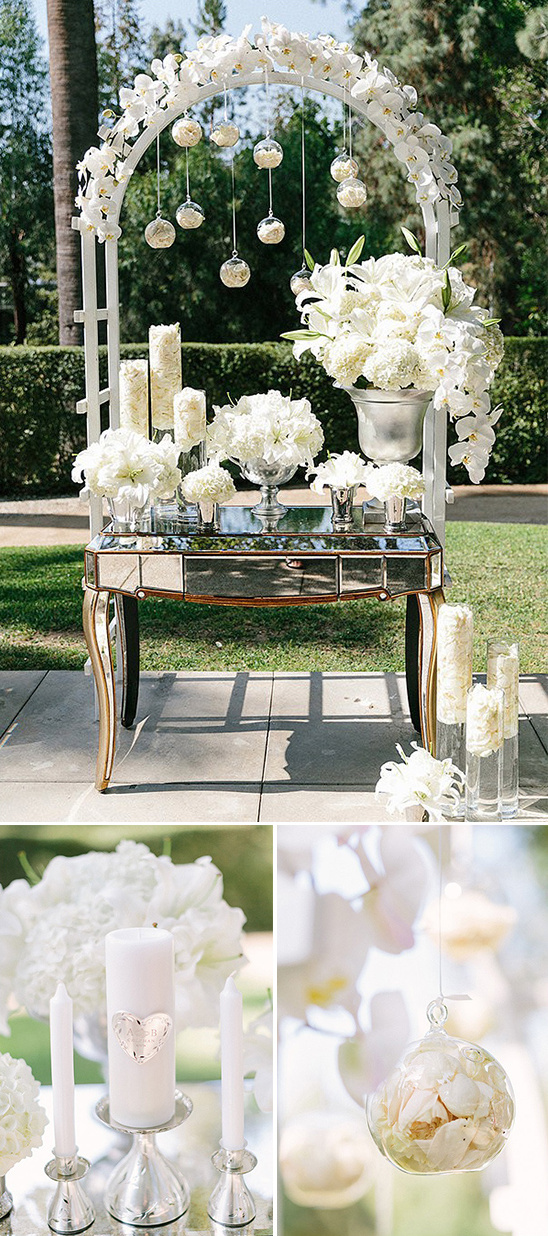 white arch and table florals with glam