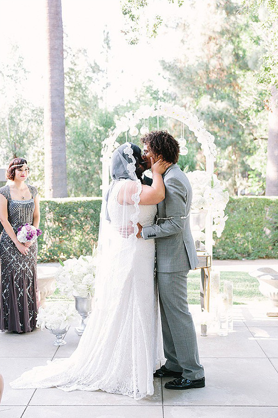 kissing the new bride