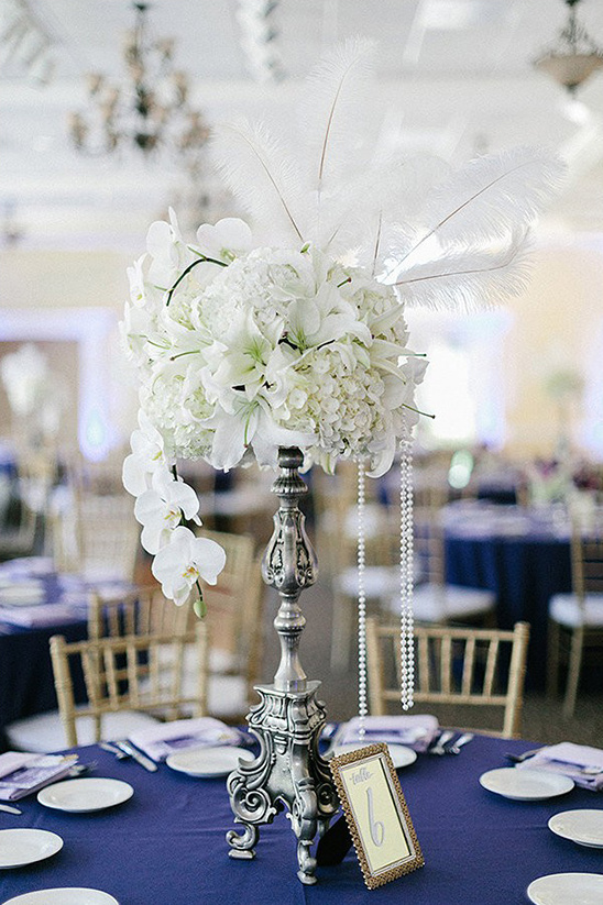 white floral and feather centerpiece