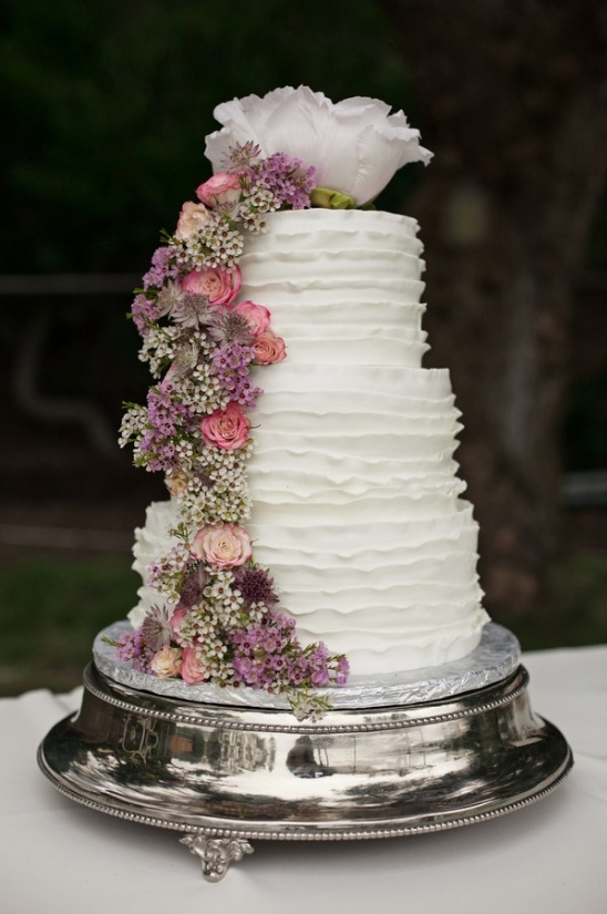 purple and pink floral ruffle wedding cake