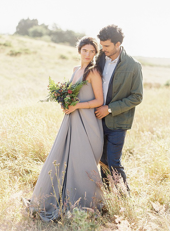 grey bridesmaid dress and wildflower bouquet