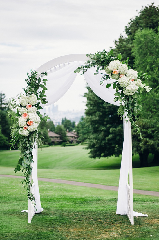 floral decorated wedding arch
