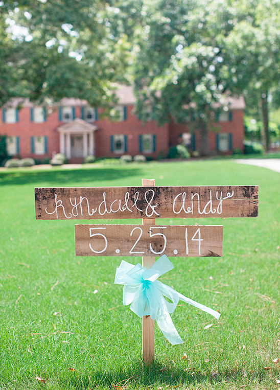 wooden post wedding sign
