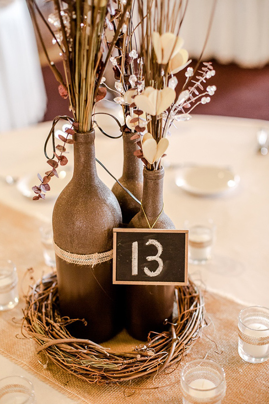 DIY painted wine bottle centerpieces
