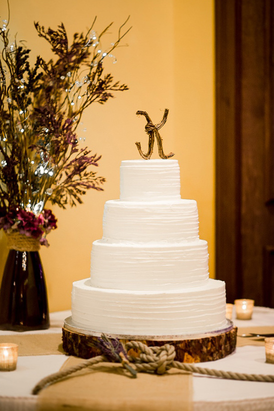 classic white cake with wicker monogram topper