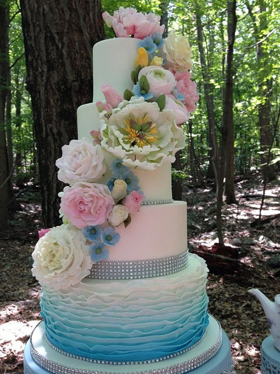 pastel floral covered wedding cake
