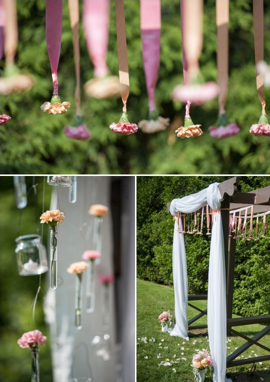 hanging flower bud decorated wedding arch