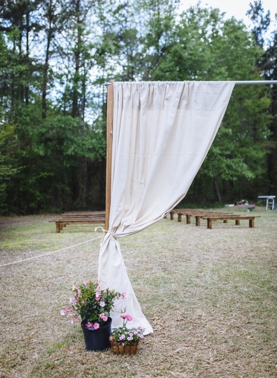 create a ceremony entrance at a wide open venue