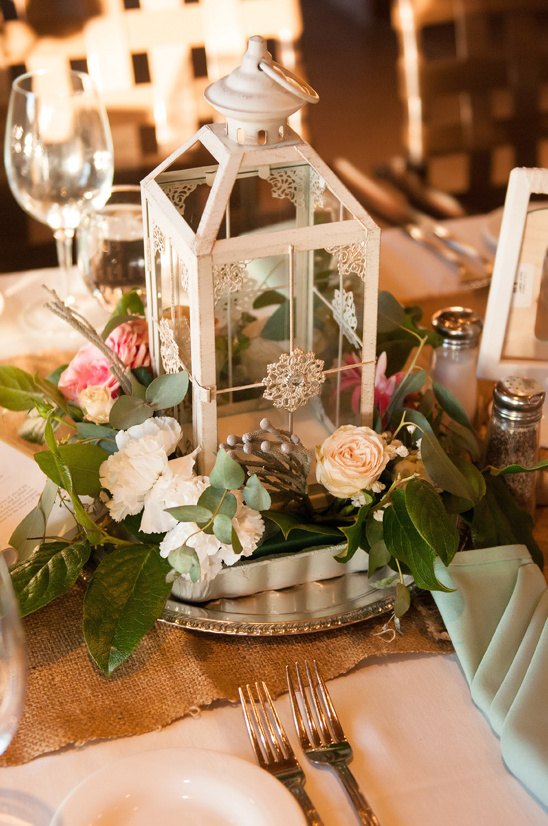 floral and white lantern centerpiece