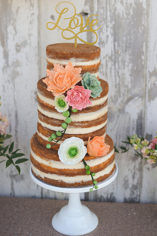 naked cake with love cake topper