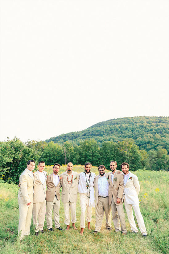 cream and white attire with barefoot groom and best man