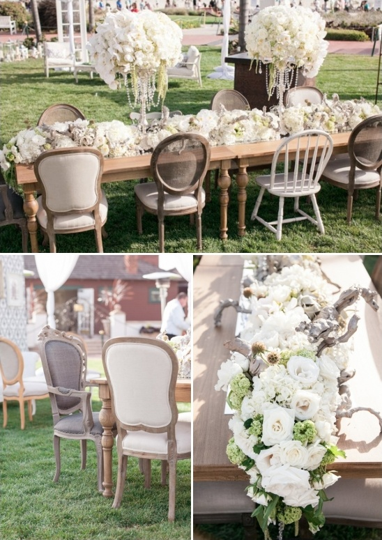 outdoor seating with elegant white flower and driftwood centerpieces