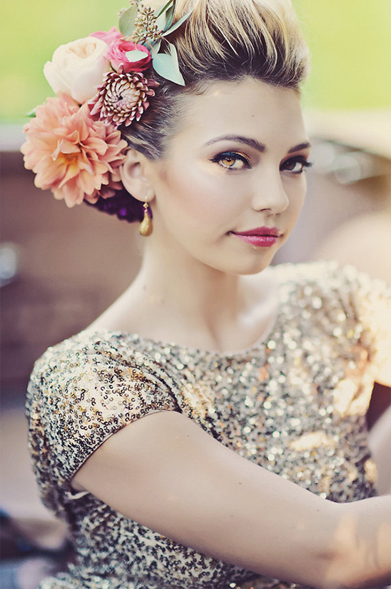 oversized floral hairpiece and dramatic glam makeup
