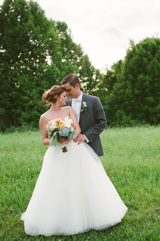 outdoor wedding by a pond