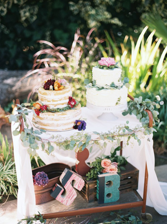 wedding cake table with book cut initials