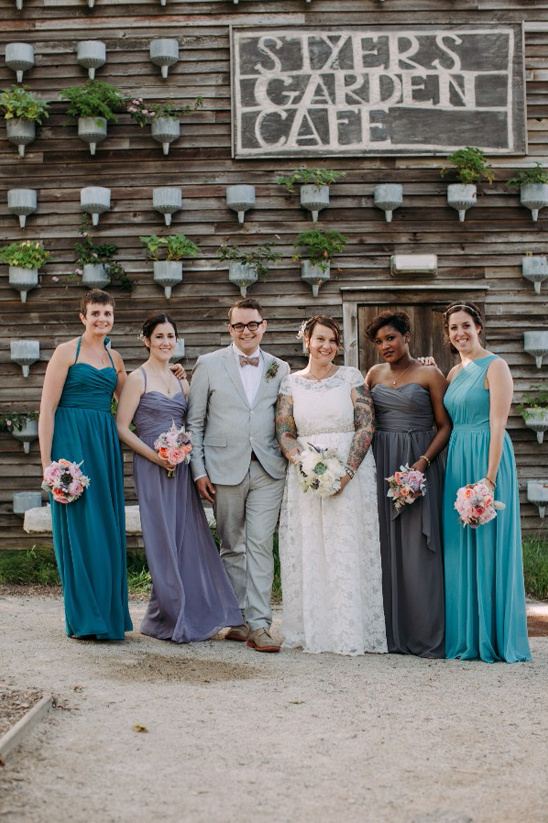 assorted blue and grey bridesmaids and man of honor