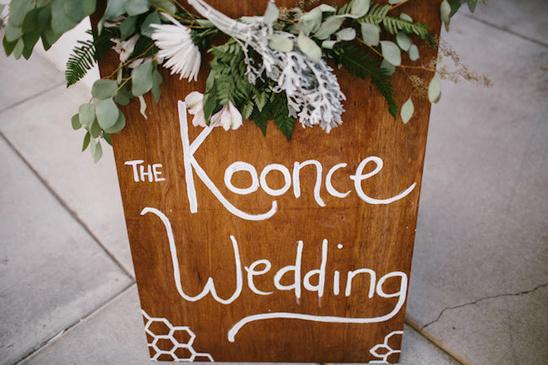 wooden wedding sign with flower garland