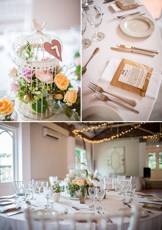 flower filled bird cage centerpiece and table number
