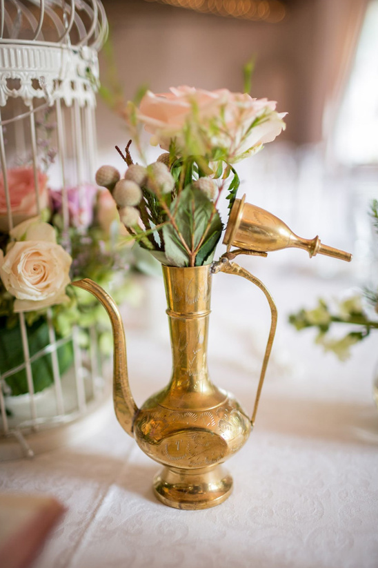 vintage brass watering can turned bud vase